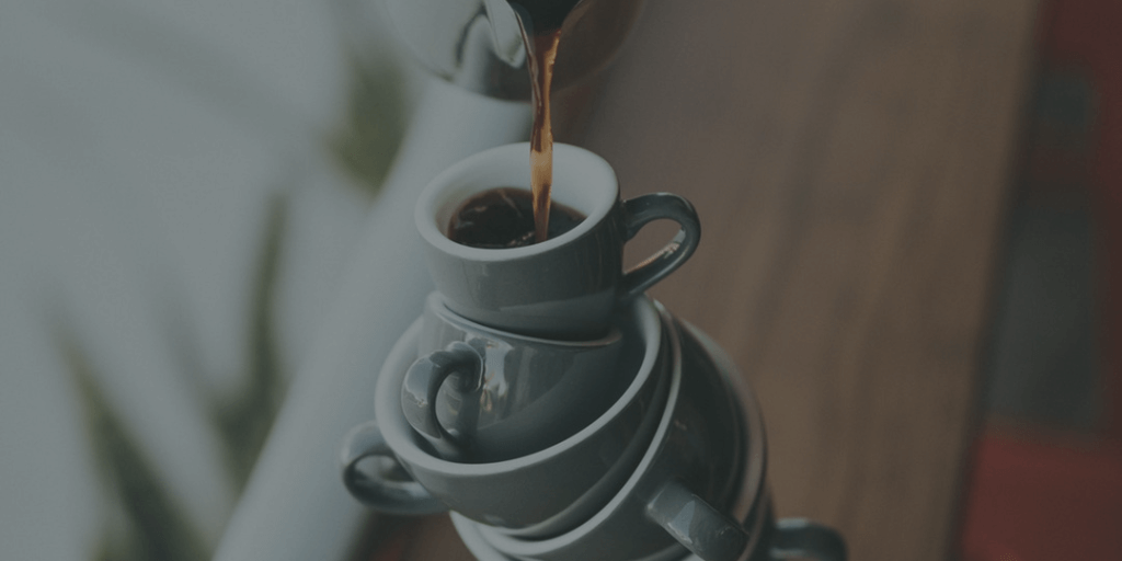 Pouring coffee into multiple cups