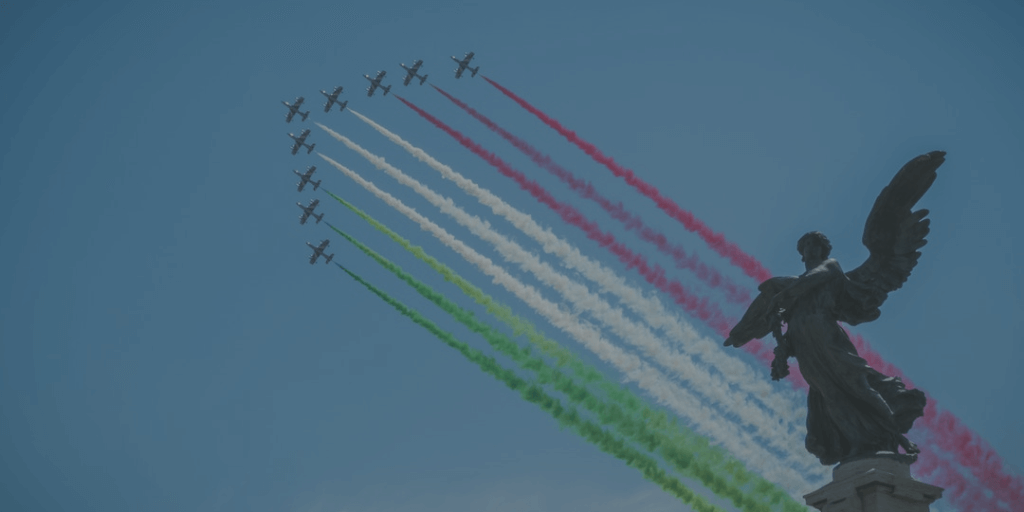 Italian jets in sky form colors of Italian flag next to angel statue