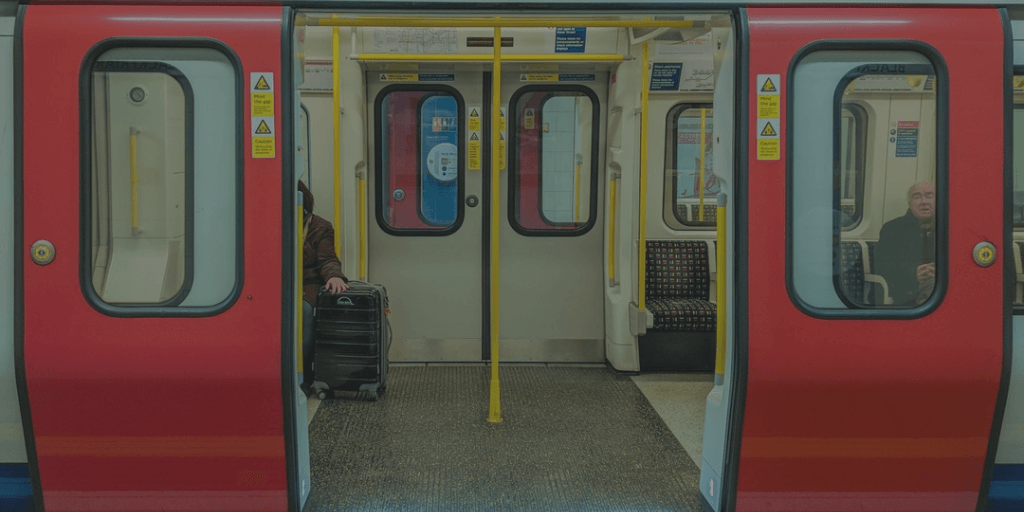 Red subway car with doors open