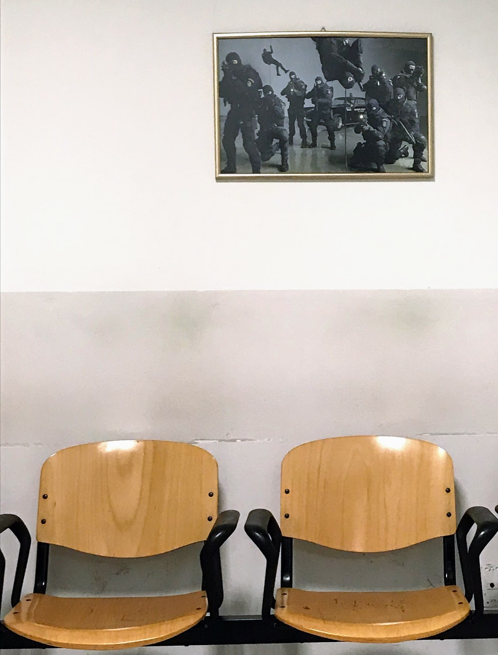 Framed photo in waiting room of Milan questura office
