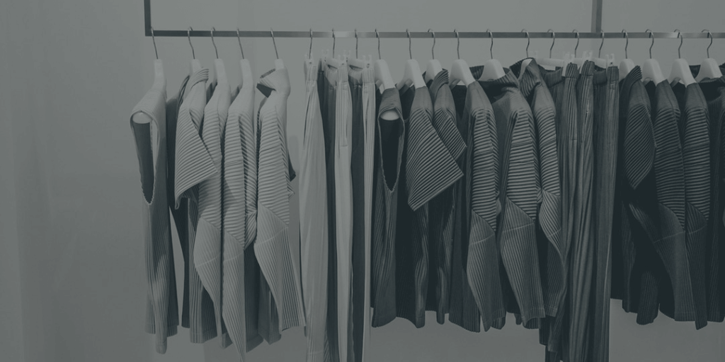 Black, grey, white clothes hanging neatly coordinated, KonMari method
